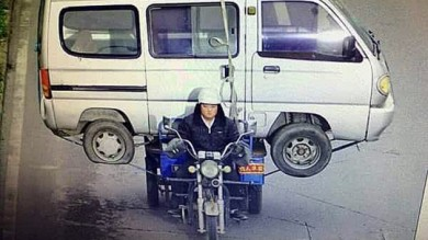 Man Carries Huge Minibus On Back Seat Of Three Wheeled Motorbike