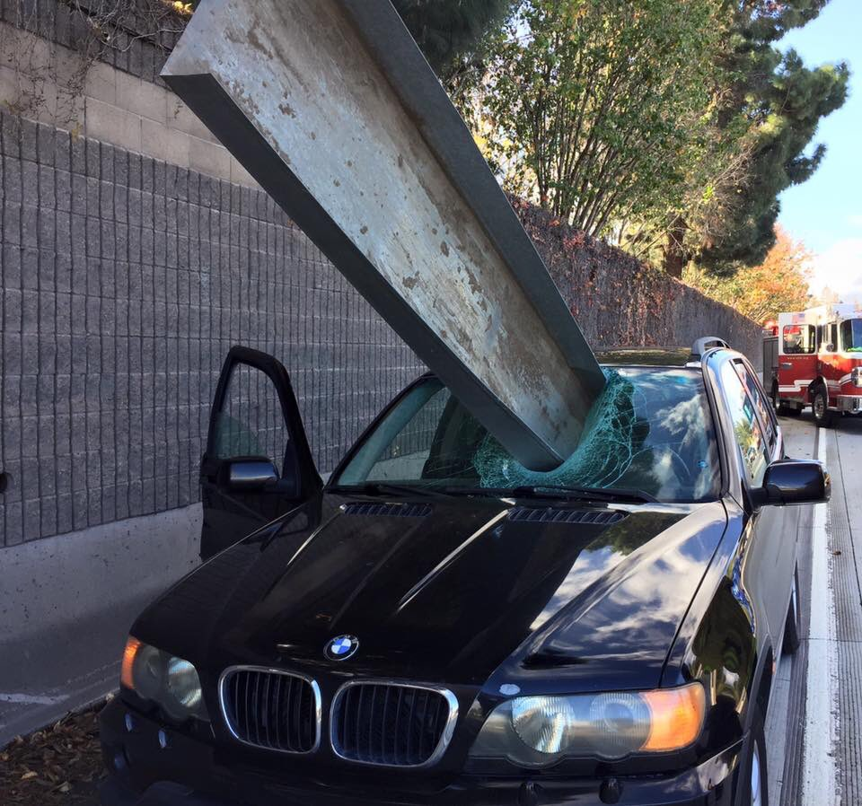 Beam Impales Beemer, Driver Is Miraculously Still Beaming