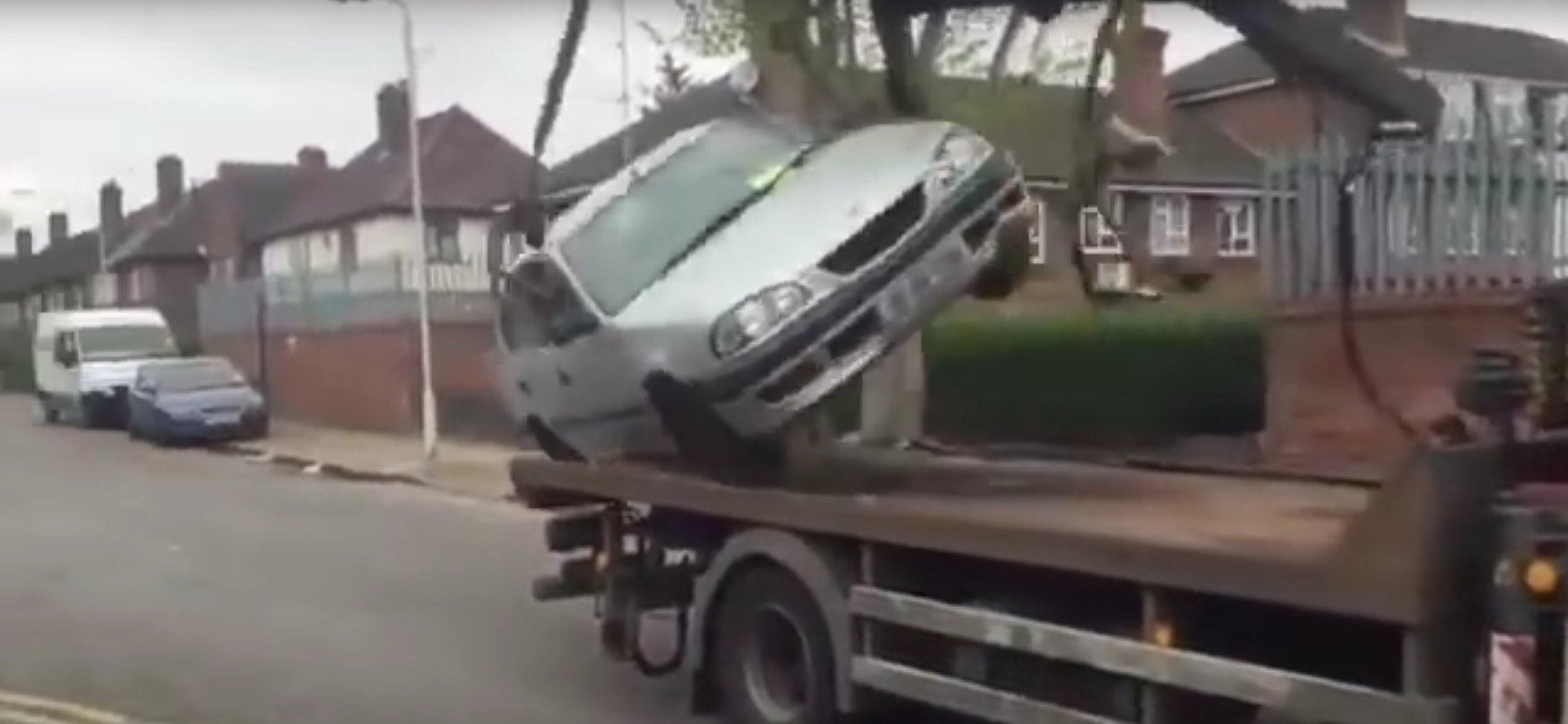 Think You Can Drive A Car Off A Tow Truck? Think Again…