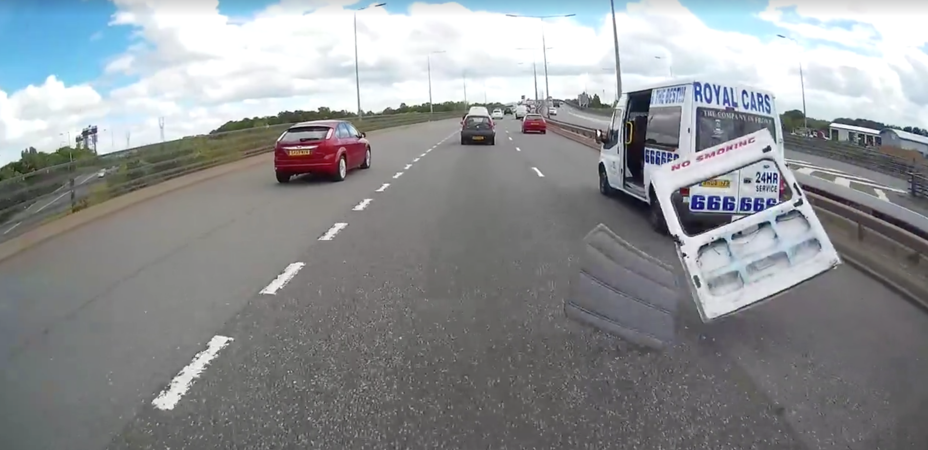 Dashcam Catches Passing Minibus Blowing Its Bloody Door Off…