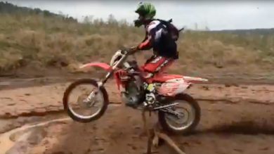 dirt biker crashes into mud