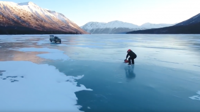 Ice Skater Uses Chainsaw To Glide Across Frozen Lake