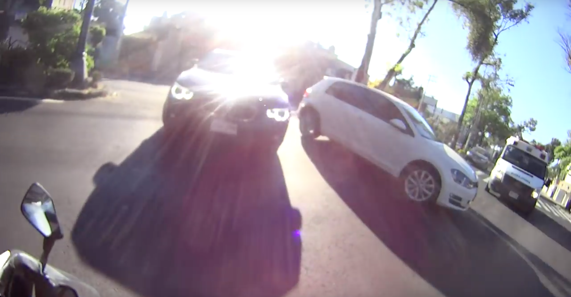 VW Golf Driver Fails To Spot Very Obvious Biker Coming Towards Him