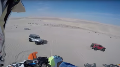 Dirt Biker Has Lucky Escape While Dune Jumping