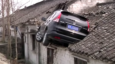 Driver Overcorrects – And Lands On Roof Of House