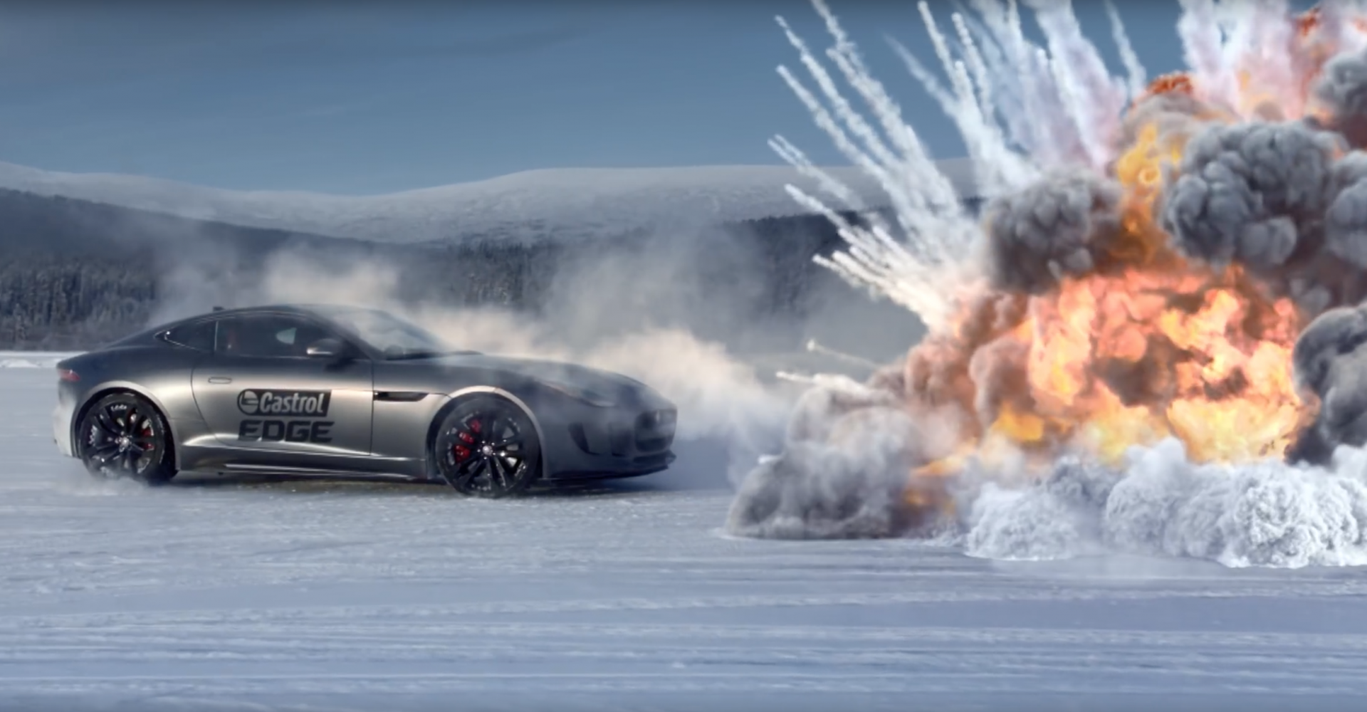 Stunt Driver Takes On Helicopters, Tanks And A Nuclear Sub On Ice Lake