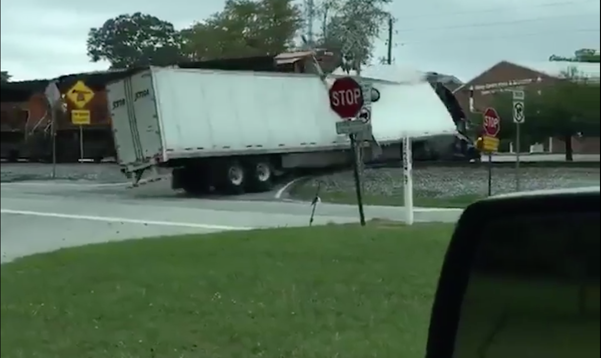 Truck full of sweets is obliterated by a train