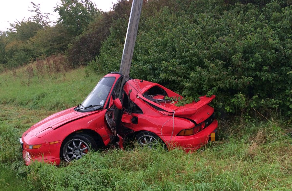 Hydroplaning driver has lucky escape after wrapping Toyota MR2 around lamppost