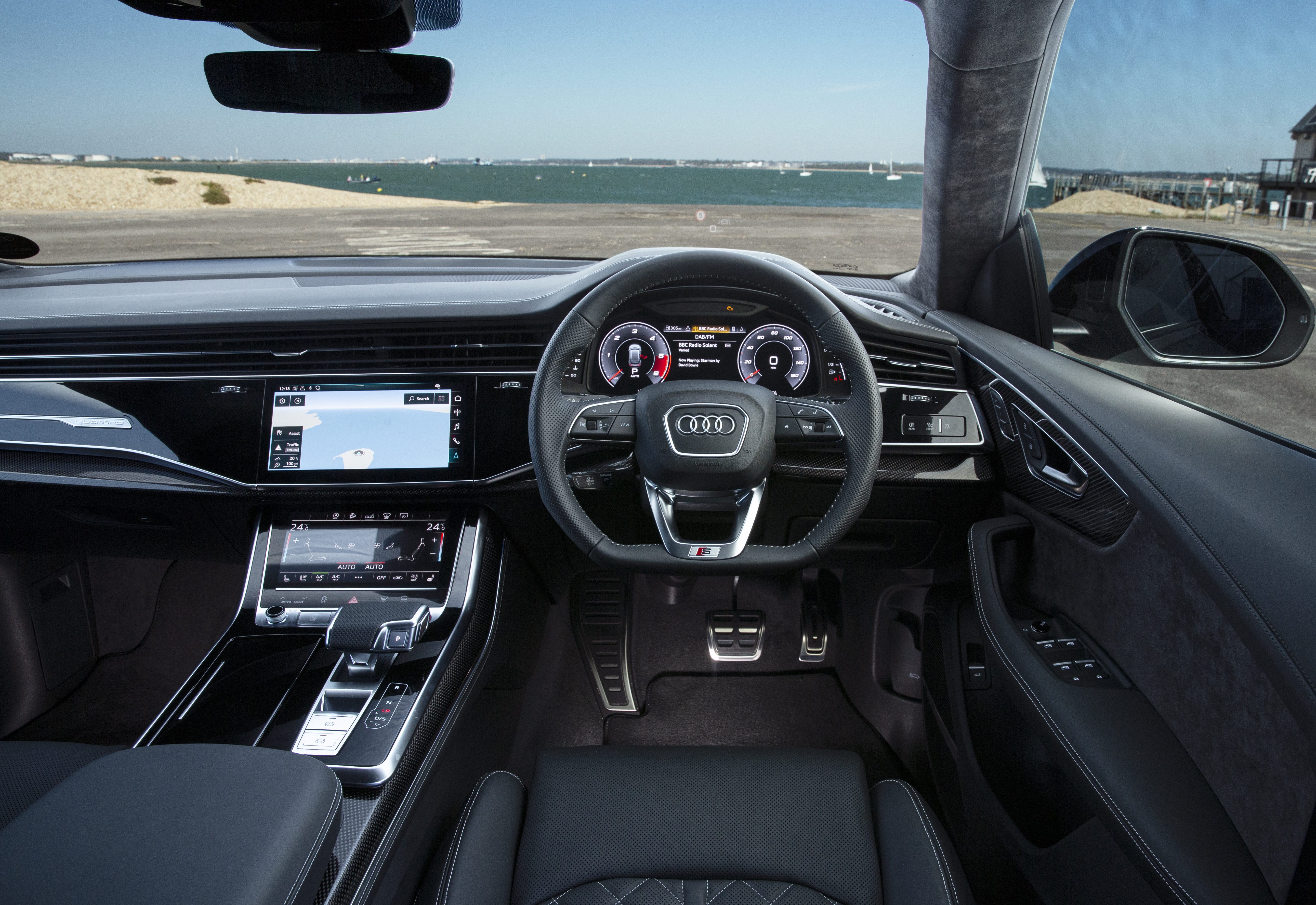 The interior is dominated by a twin screen infotainment system