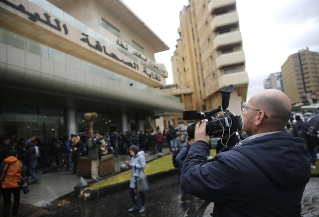 Journalists gather outside the Lebanese Journalists Syndicate in Beirut where ex-Nissan chief Carlos Ghosn was holding a press conference