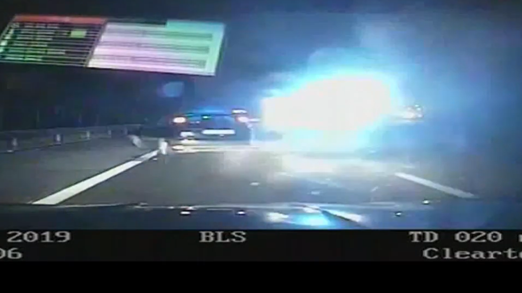 Footage released of motorway crash which left police car in flames