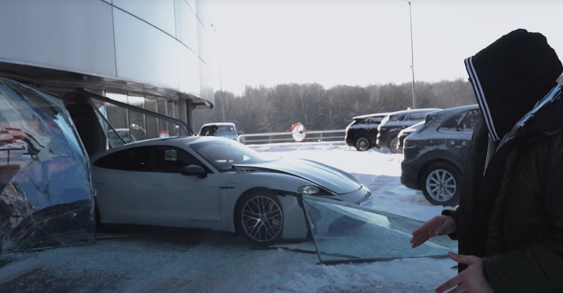 Russian YouTuber crashes Porsche Taycan through dealership window