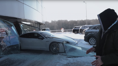 Russian YouTuber crashes Porsche Taycan through dealership window